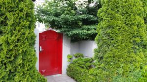 Melissa's Red Door commands attention, yet secures privacy.