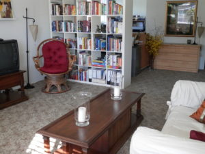 The Home Office tucked behind the bookcase is functional and practical. ~After feng shui clean up.